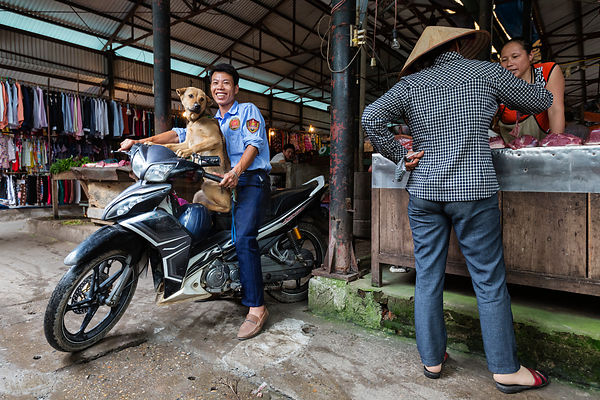 Portrait of a Man on a Motobike with his Dog