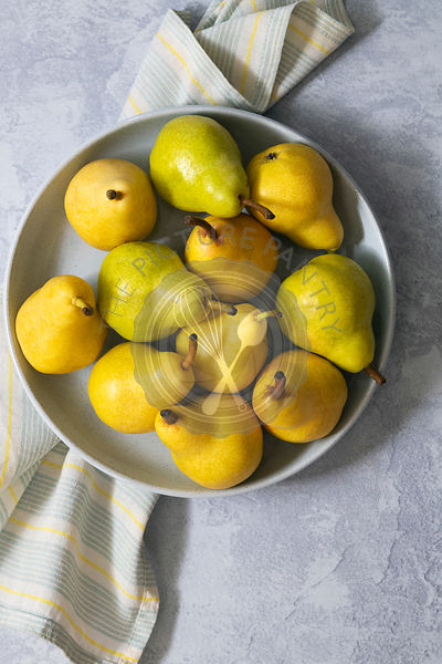 Organic pears in a bowl.