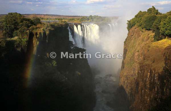 Main Falls with rainbow, taken from the west in late afternoon sun, Victoria Falls, Zimbabwe and Zambia