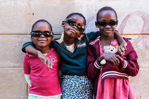 Young Girls Posing with Sunglasses
