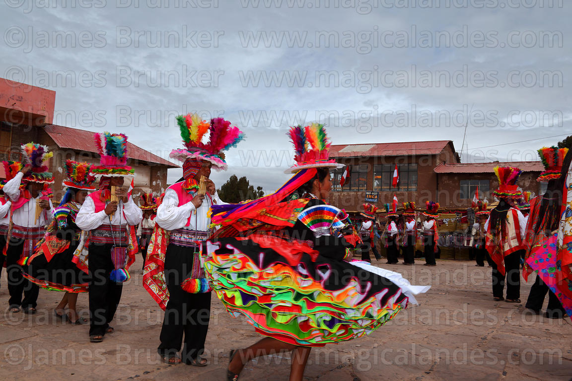 Suri Sikuri musicians and dancer at San Santiago festival , Taquile Island , Peru