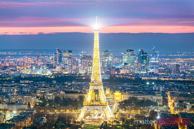 Eiffel tower and city of Paris from the top at dusk, France