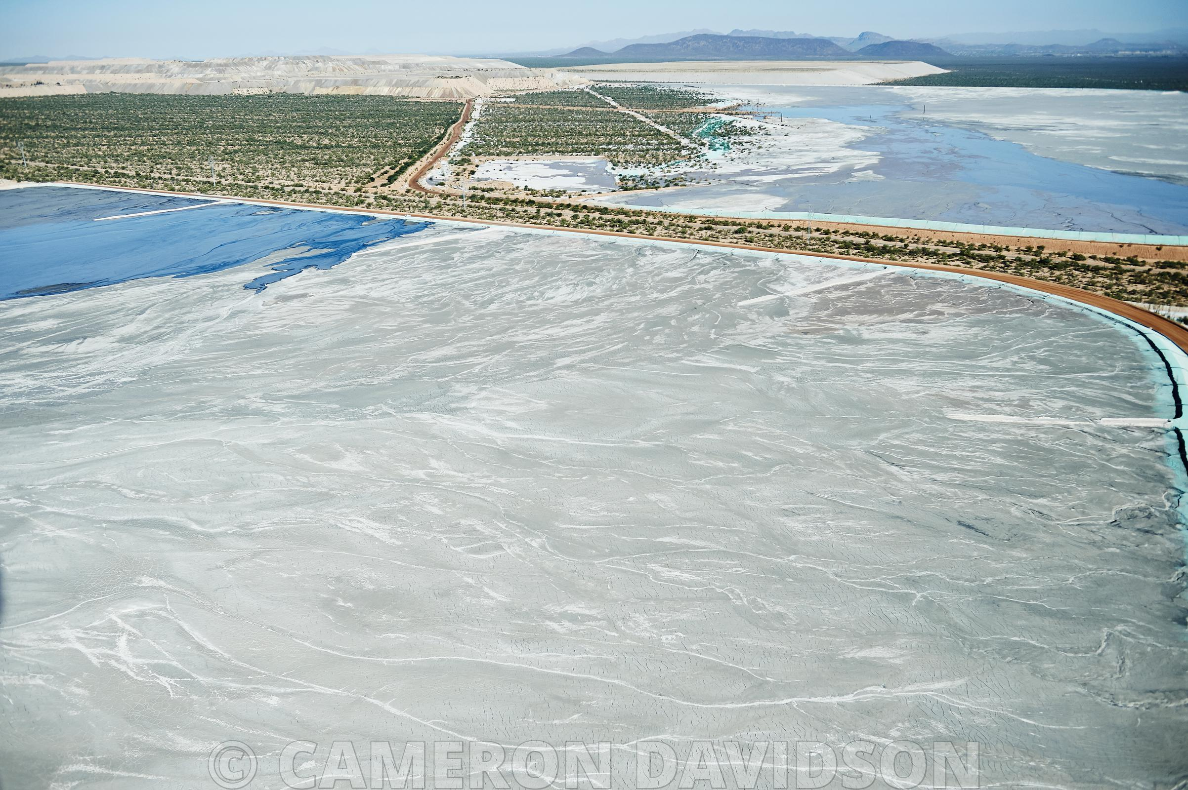 Aerial photogrpah of retention ponds for a copper and gold mine in Arizona