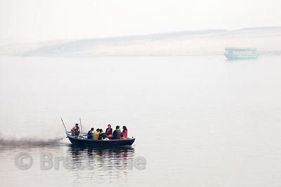 A boat puts out black smoke on the Ganges River near Ramnagar, Varanasi, India.