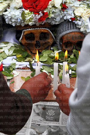 Devotees offering candles to skulls, Ñatitas festival, La Paz, Bolivia