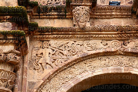Detail of carving of angel playing trumpet above main side entrance of St John the Baptist of Letrán / San Juan Bautista de L...