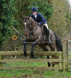 Jodie Nicholls jumping a hunt jump near Knossington Spinney