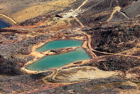 View looking down from Mt Chacaltaya to lakes near Milluni coloured by mining activity, Bolivia