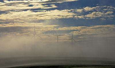 Wind towers in the fog