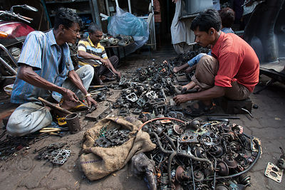 Men sort metal for recycling at a small shop in Chor Bazaar, also known as the Thieves Market, Mumbai, India.