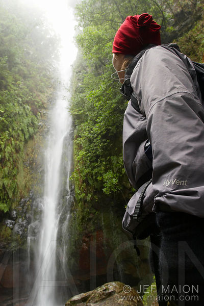 Hiker admiring a waterfall