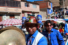 Man wearing miner's helmet with beer can holders playing cymbals, Chutillos festival, Potosí, Bolivia