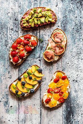 Different sandwiches, strawberry, fig, nectarine, avocado, tomato
