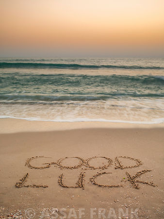 Sand writing - Good Luck written on beach