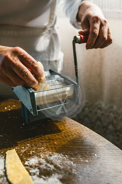 A woman making homemade pastain the traditional way