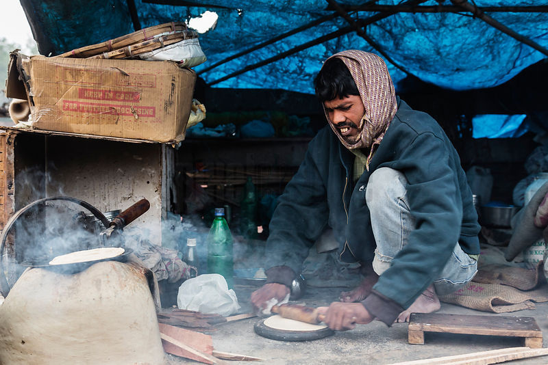 Man Making Chapatis at Roadside Shanty