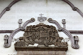 Detail of carving above window on entrance facade of San Pedro church, La Paz, Bolivia