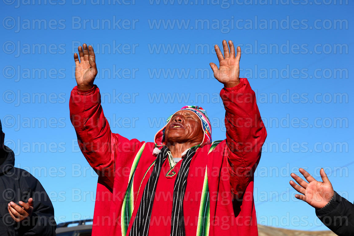 Aymara shaman or yatiri praying during ritual for Pachamama, La Cumbre, Bolivia