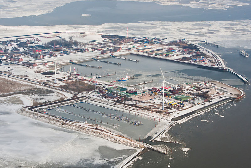 Aerial view of frozen harbour of Borkum in winter with ice sheets and snow, East Frisia, North Sea, Lower Saxony, Germany Feb...
