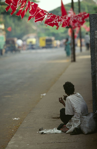 India - Kerala - A man begs on the street