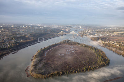 Douglas Island on Fraser River with Port Man Bridge. Taken during a foggy morning.