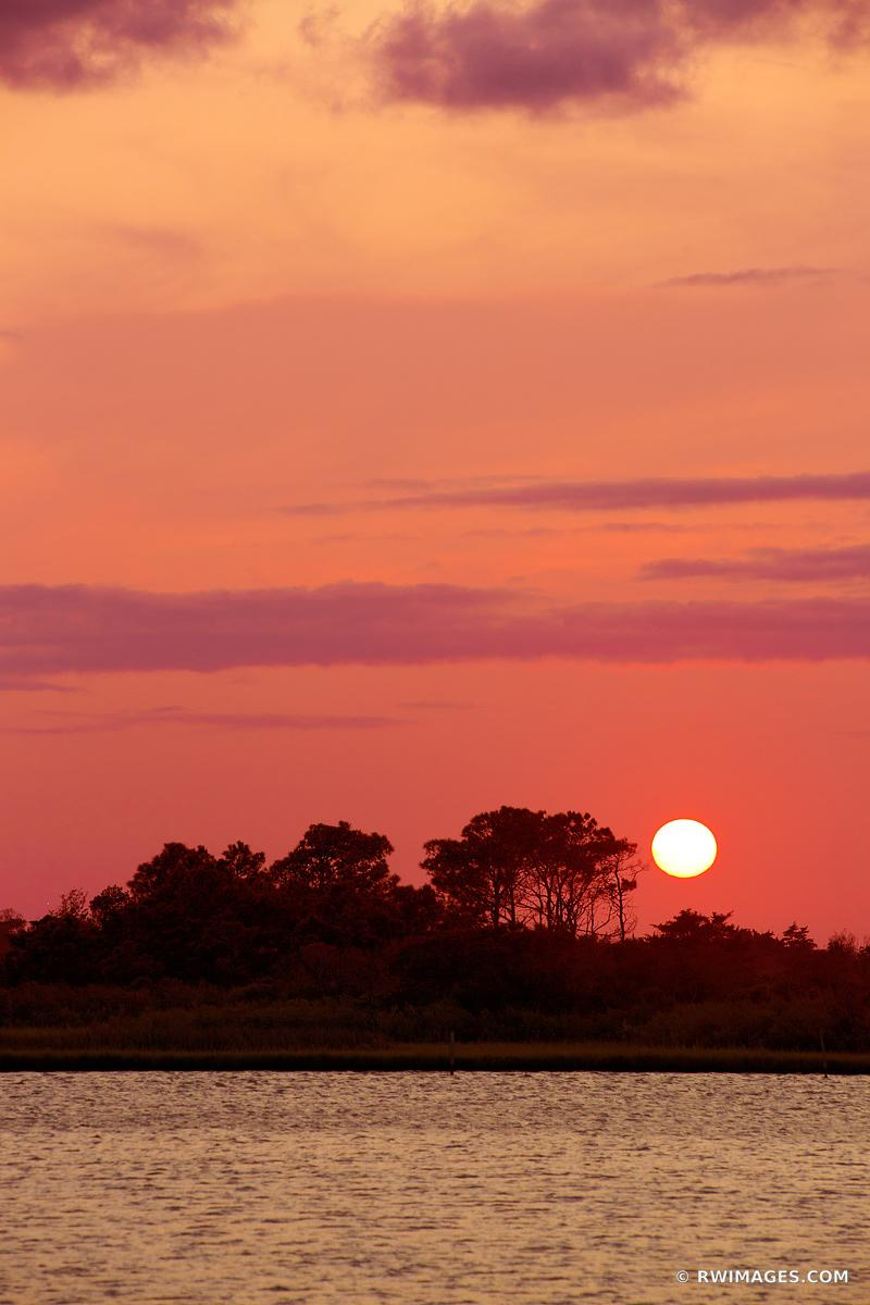SUNSET OVER CHINCOTEAGUE BAY ASSATEAGUE ISLAND NATIONAL SEASHORE MARYLAND COLOR VERTICAL
