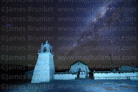 Milky Way galactic core above Guallatiri church and belfry, Las Vicuñas National Reserve, Region XV, Chile