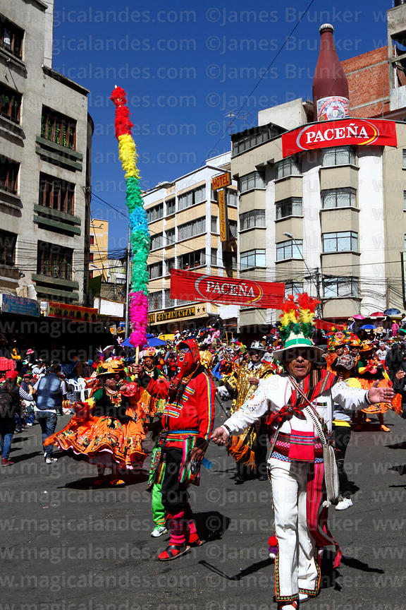 Kusillo figure taking part in parades at Gran Poder festival with waca tokoris dance group, La Paz, Bolivia