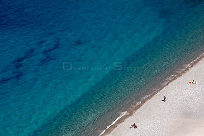 Tourists on the beach in the Gulf of Porto UNESCO World Heritage Site, Regional Natural Park of Corsica, Corsica, France, Sep...