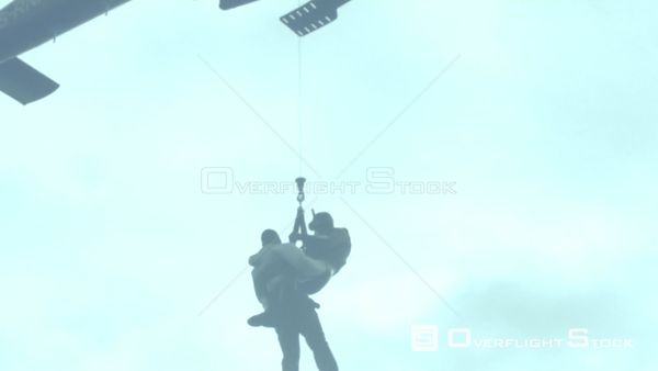 Aerial of two men being airlifted by a rescue helicopter Cape Town Western Cape South Africa