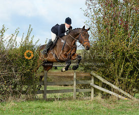 Zoe Hatton jumping a hedge near Little Dalby. Quorn Hunt Opening Meet 2018