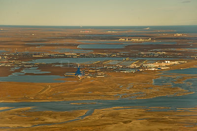 Aerial landscape view of Prudhoe Bay oil fields, central arctic coast, North Slope, Alaska.