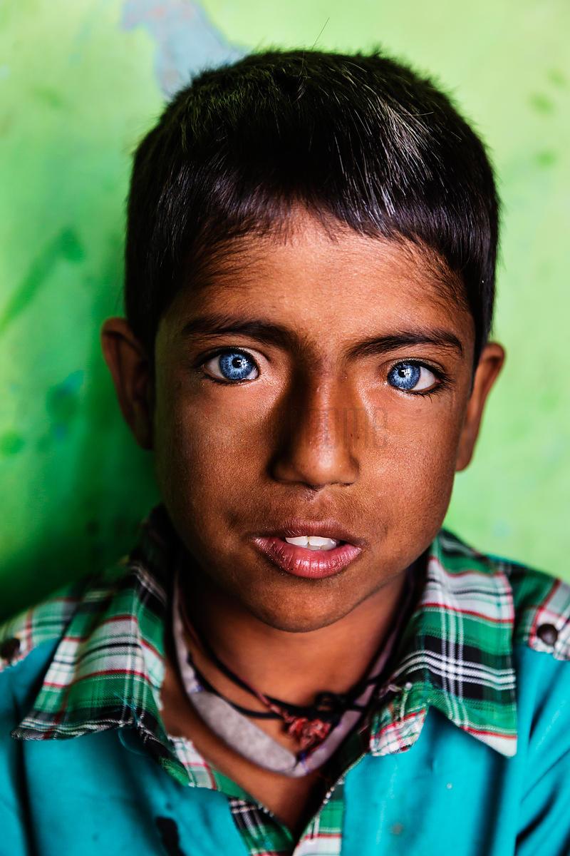 Young Boy with Blue Eyes at Delhi Shanty Town