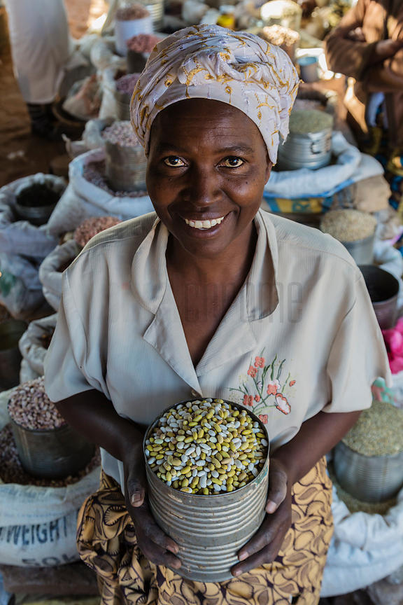 Woman Selling Beans at Market