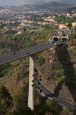Aerial view of dual carriageway road carried by bridge high over a valley, near Funcal, Madeira, November