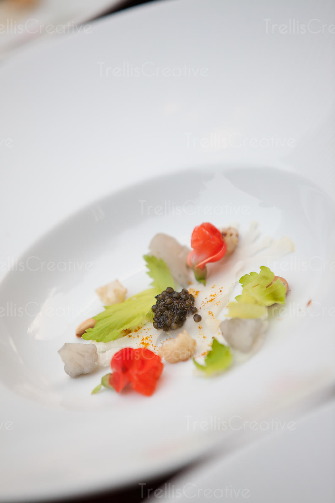 Delicate white dish with caviar
