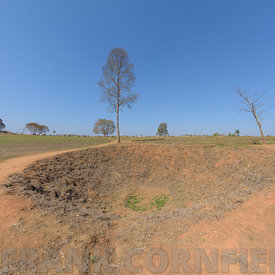 A large bomb crater at the Plain of Jars, Thong Hai Hin Site 1, at Thomghaihin near the town of Phonsavan in the province Xie...