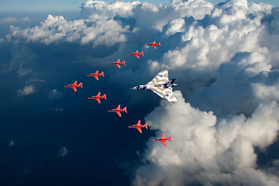 Red Arrows and Vulcan above clouds