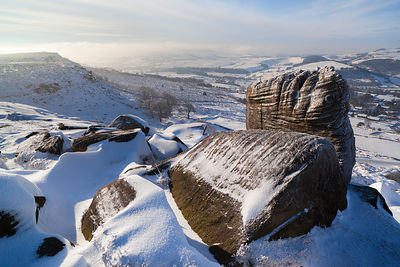 Snowy, frosted boulders on Curbar Edge Peak District