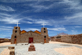 Stone church at Ollagüe, Aucanquilcha volcano in background, Region II, Chile