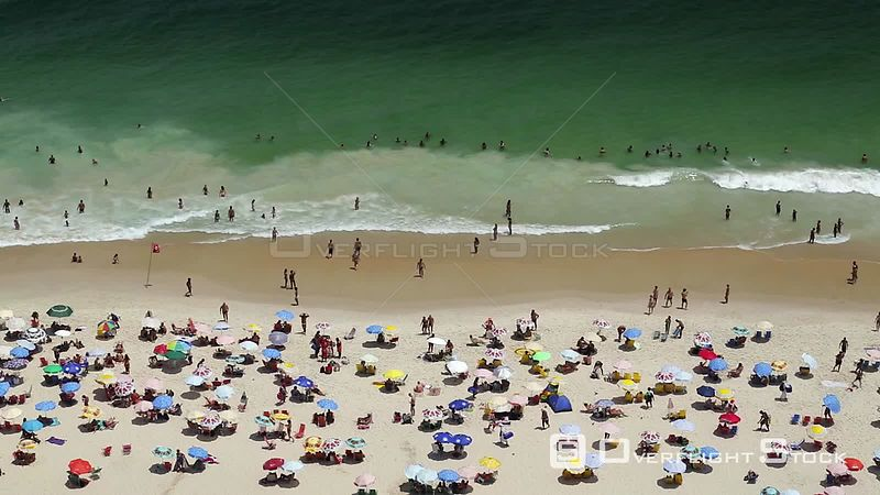 People swimming and sunbathing on Copacabana beach, Rio de Janeiro, Brazil, September 2016.