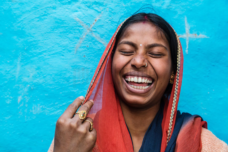 Woman Laughing Shyly at New Delhi Shanty