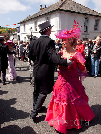 a couple dance in the Helston Flora Day parade
