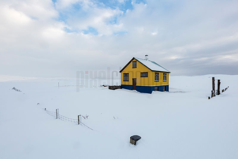Yellow House in a Snow Covered Landscape