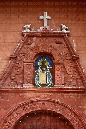 Figure of Virgen de las Peñas in window above main entrance of church, Peñas, La Paz Department, Bolivia
