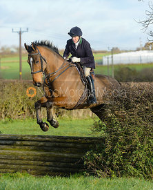 Gilly Bradley jumping a tiger trap - The Quorn Hunt at Woodpecker Farm
