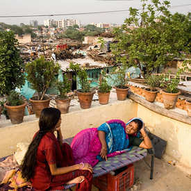 Radhika and her neighbour Saroj on her roof garden in one of Delhi's largest slum's Kesumpur Pahari. The slum, built more tha...
