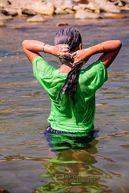 Young Hmong Woman Washing Hair in River