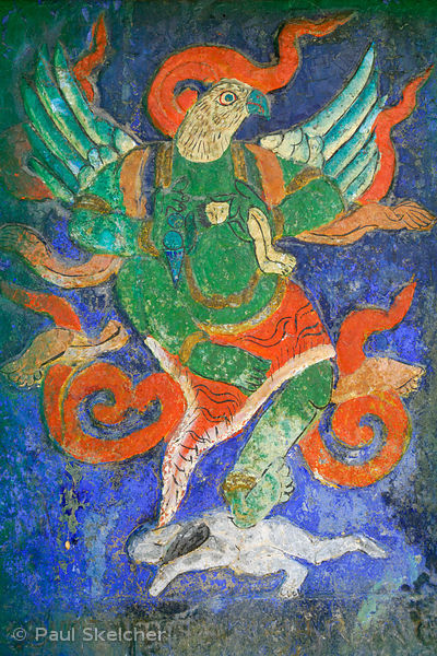 Old painted carving on stone tablet, on the Lingkhor pilgrim circuit as it ascends Chagpo Ri mountain, depicts winged human w...