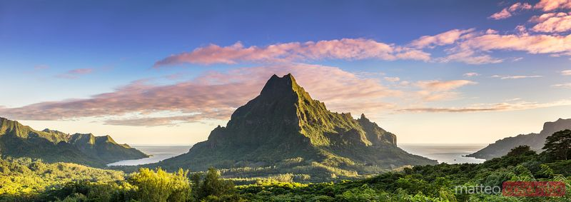 Awesome sunrise over valley and peak, Moorea, French Polynesia